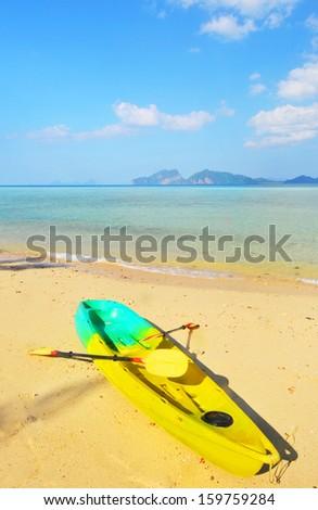 Yellow kayaks on the beach. - stock photo