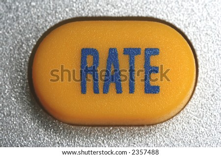 "yellow key of a pocket calculator, inscription ""RATE"""