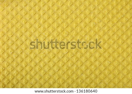 Yellow kitchen sponge rubber foam as background texture - stock photo