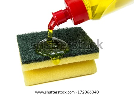 Yellow kitchen sponges and bottle of dishwashing liquid isolated over white background - stock photo