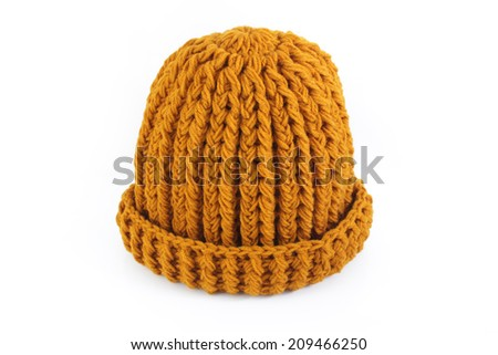 Yellow knitted wool hat isolated on white background - stock photo