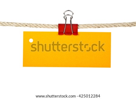 Yellow label on a rope isolated on white background, closeup - stock photo