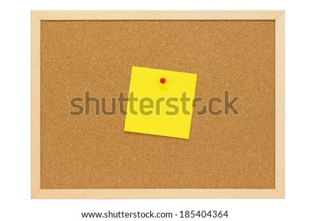 Yellow leaflet on a pinboard of cork  - stock photo