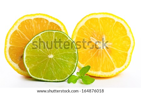 yellow lemon and lime green with mint on a white backgrou - stock photo