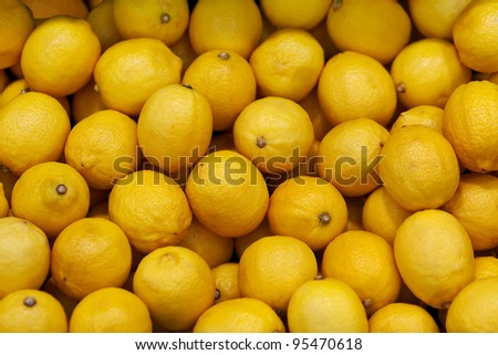 Yellow lemons on the market counter - fruit background