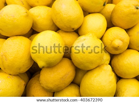 yellow lemons textures backgrounds.  Group of fresh lemons. - stock photo