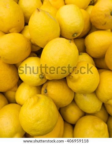 yellow lemons textures backgrounds.  Group of fresh lemons. - stock photo