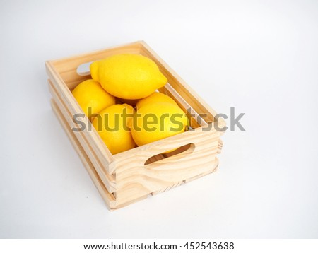 Yellow Lime and wood box with white background