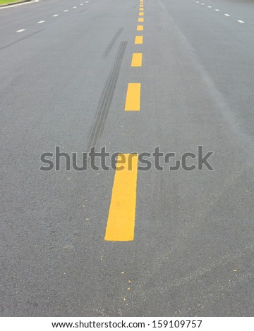 Yellow line marking on road