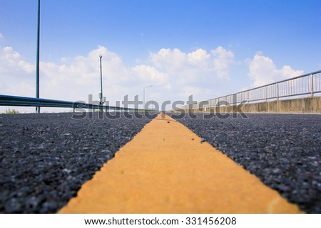 yellow line on asphalt road - stock photo