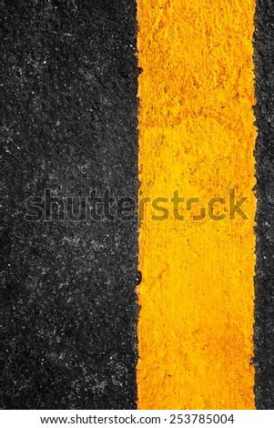 Yellow line on asphalt texture