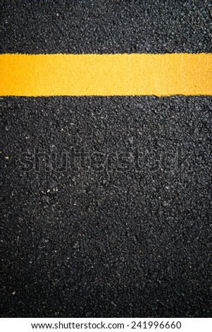 yellow line on the new road - stock photo