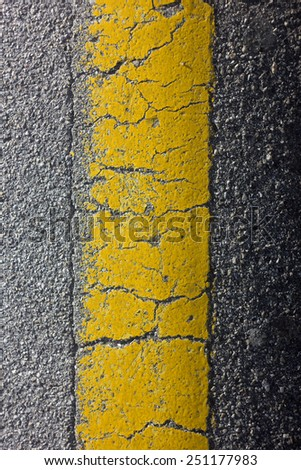 Yellow line on the pavement