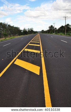 Yellow line traffic sign on the road surface