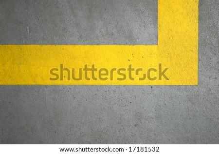 yellow lines on concrete floor - stock photo