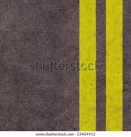Yellow lines on the asphalt road - stock photo