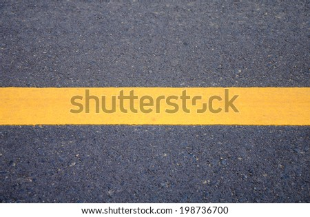 Yellow lines on the road. - stock photo