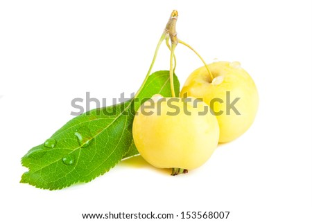 Yellow little apples isolated on white