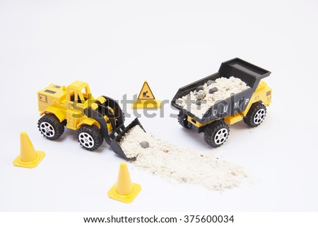 Yellow loader toy isolated on white background - stock photo