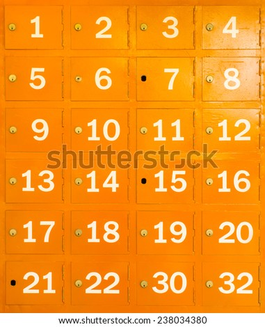 yellow locker with number in front of box - stock photo