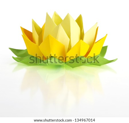 Yellow lotus origami isolated on a white background - stock photo