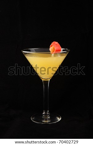 yellow martini cocktail with elegant red decoration