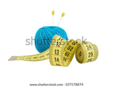 Yellow measuring tape and blue thread isolated on white