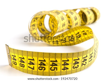 Yellow  measuring tape close-up isolated on white background - stock photo