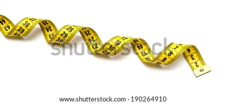 Yellow measuring tape isolated on white background - stock photo