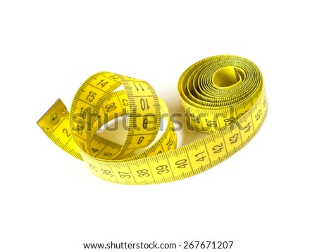 Yellow measuring tape isolated on white background closeup