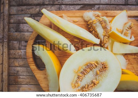 yellow melon Cantaloupe  slices on broun background desk rustic style