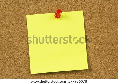 Yellow memo stick on board background
