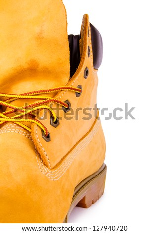 Yellow men's boots isolated on white background - stock photo