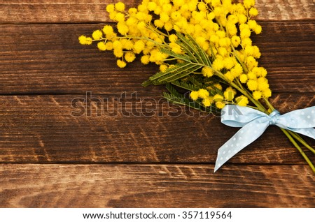 Yellow Mimosa bouquet on a rustic wood panels