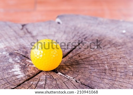 Yellow Miniature Golf Ball On White Background. - stock photo
