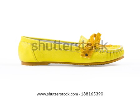 yellow moccasin Isolated on white background - stock photo