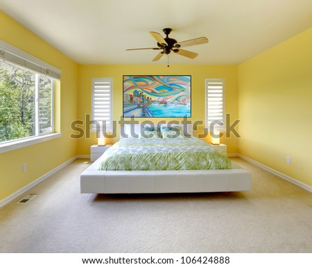 Yellow modern bedroom interior with white bed. - stock photo