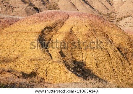 Yellow Mounds in the Badlands National Park, South Dakota. - stock photo
