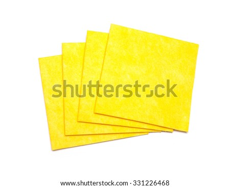 Yellow napkins for cleaning. On a white background - stock photo