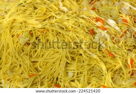 Yellow noodle fried with vegetables. Chinese food for Vegetarian Festival. - stock photo