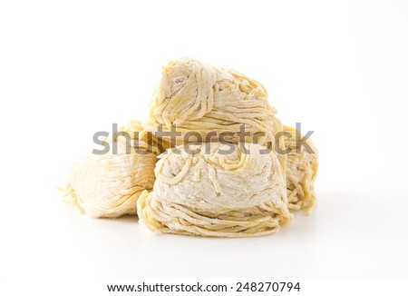 yellow noodles on white background