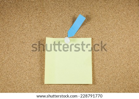 Yellow note papers on cork board background. - stock photo