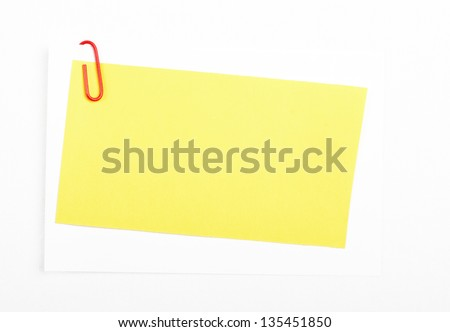 Yellow note with red paper clip