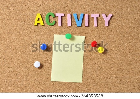 """Yellow Notepad With Alphabets """"ACTIVITY"""" On Board Background - stock photo"""