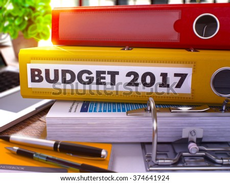 Yellow Office Folder with Inscription Budget 2017 on Office Desktop with Office Supplies and Modern Laptop. Budget 2017 Business Concept on Blurred Background. Budget 2017 - Toned Image. 3D - stock photo