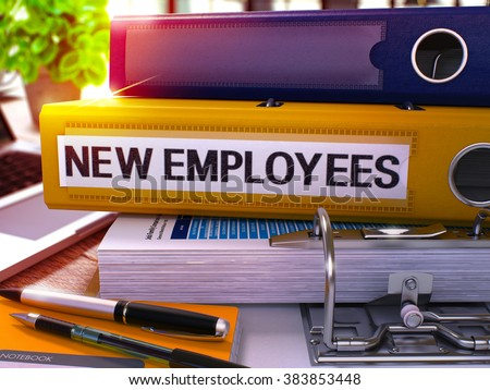 Yellow Office Folder with Inscription New Employees on Office Desktop with Office Supplies and Modern Laptop. New Employees Business Concept on Blurred Background. New Employees - Toned Image. 3D. - stock photo