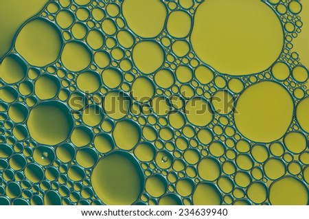 yellow oil bubbles on a water surface abstract background - stock photo
