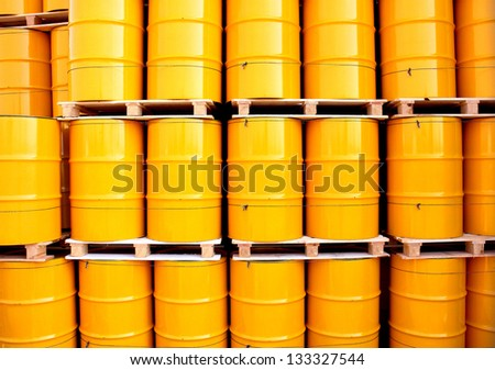 Yellow oil drums on an industrial transport site - stock photo