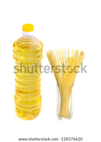 yellow oil in plastic bottle with pasta - stock photo