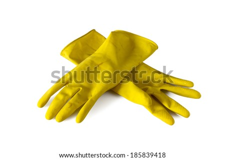 Yellow  old rubber gloves isolated on white background - stock photo